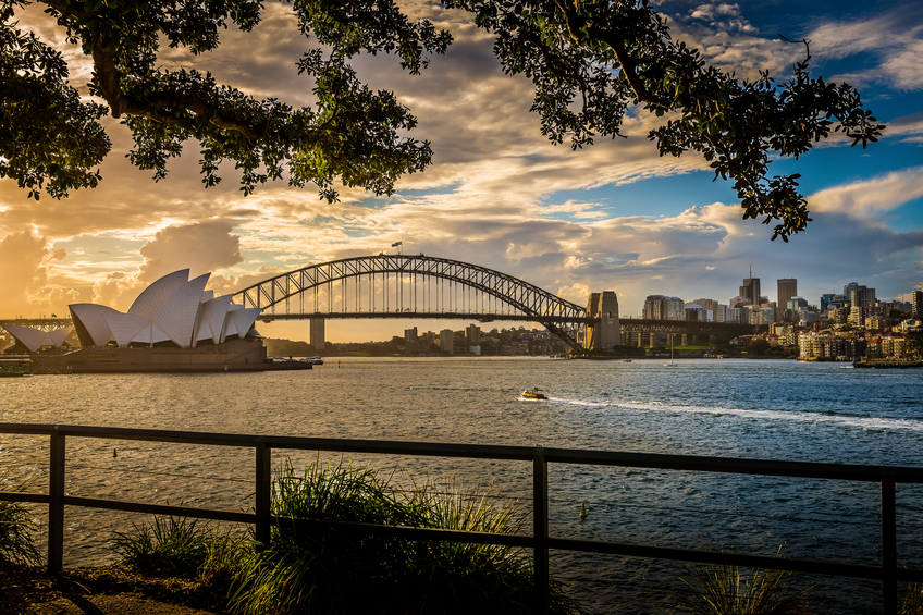 View of the iconic Sydney Opera House and Harbour Bridge from Mrs Macquarie's Chair, Sydney, Australia.