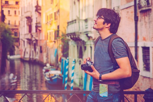 Young man travelling in Venice, Italy